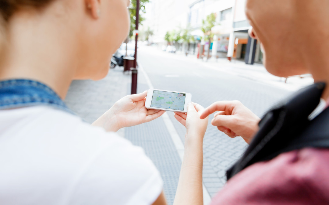 Tourists using mobile app to find their destination.